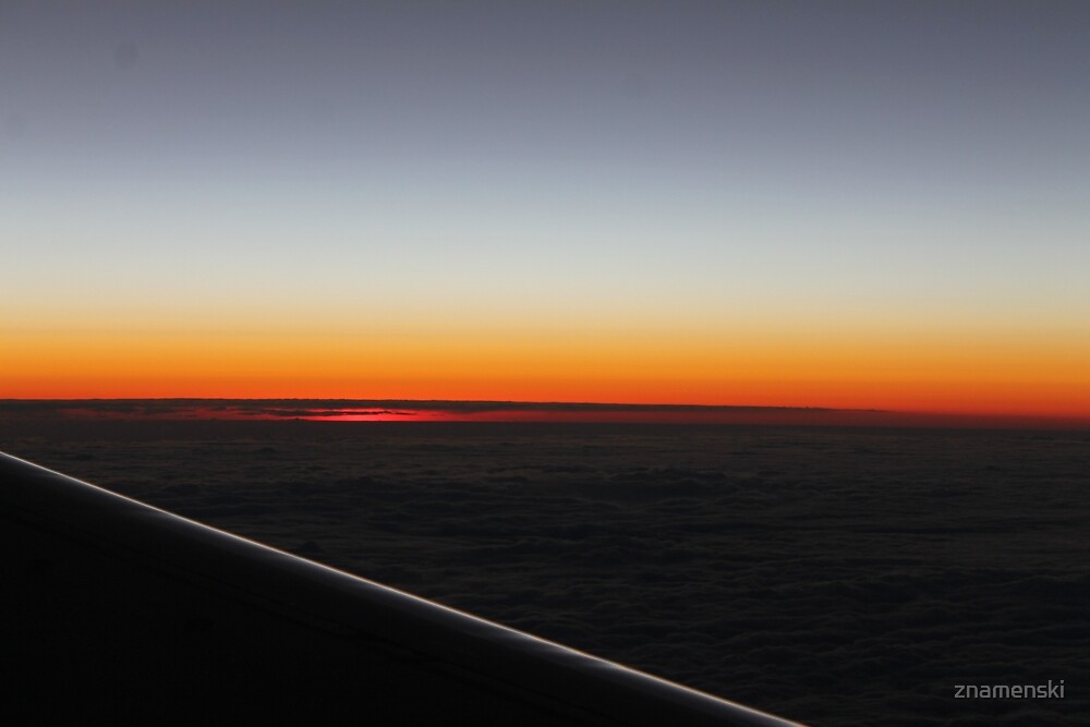 The setting sun, evening dawn, pink clouds from the side of the plane. by znamenski