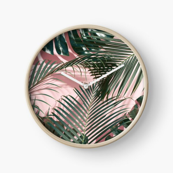 Green tropical leaves on a pink wall | Palm leaves  Clock