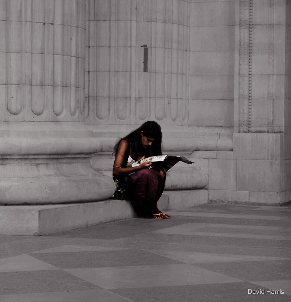 Girl reading map. by David Harris