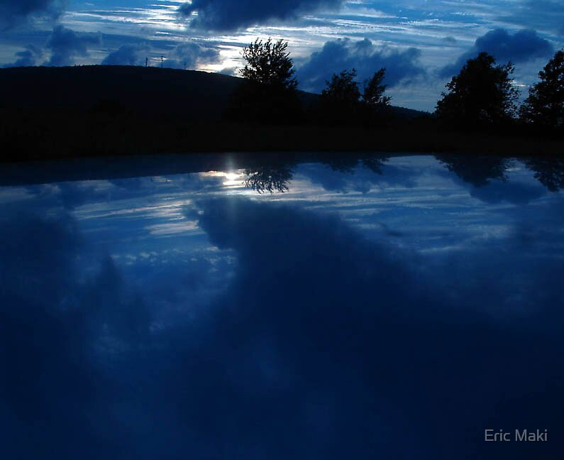 blue car roof sunset by Eric Maki