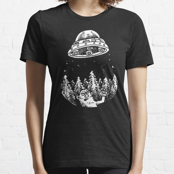 UFO buzzes Yeti in the forest Essential T-Shirt