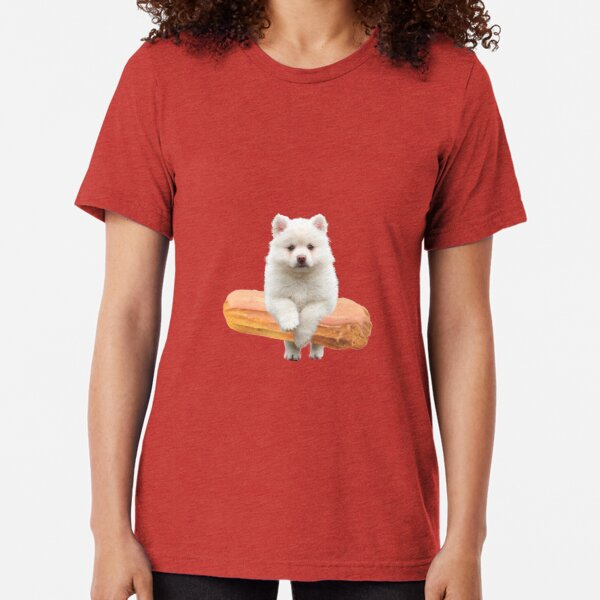 Cute Alaskan Malamute Dog jumping an éclair by Alice Monber Tri-blend T-Shirt