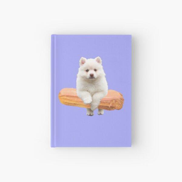 Cute Alaskan Malamute Dog jumping an éclair by Alice Monber Hardcover Journal