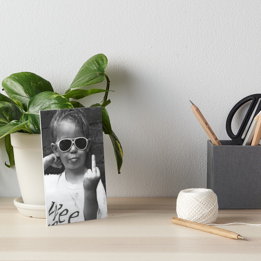 Boy Sticking His Tongue Out Art Board Print
