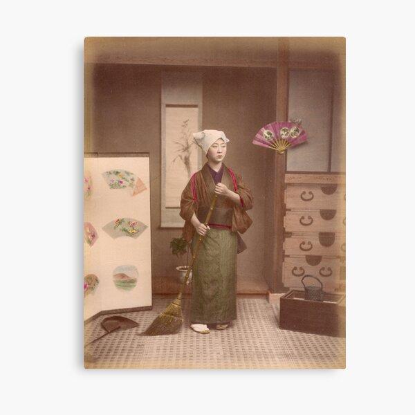 Japanese girl sweeping Canvas Print