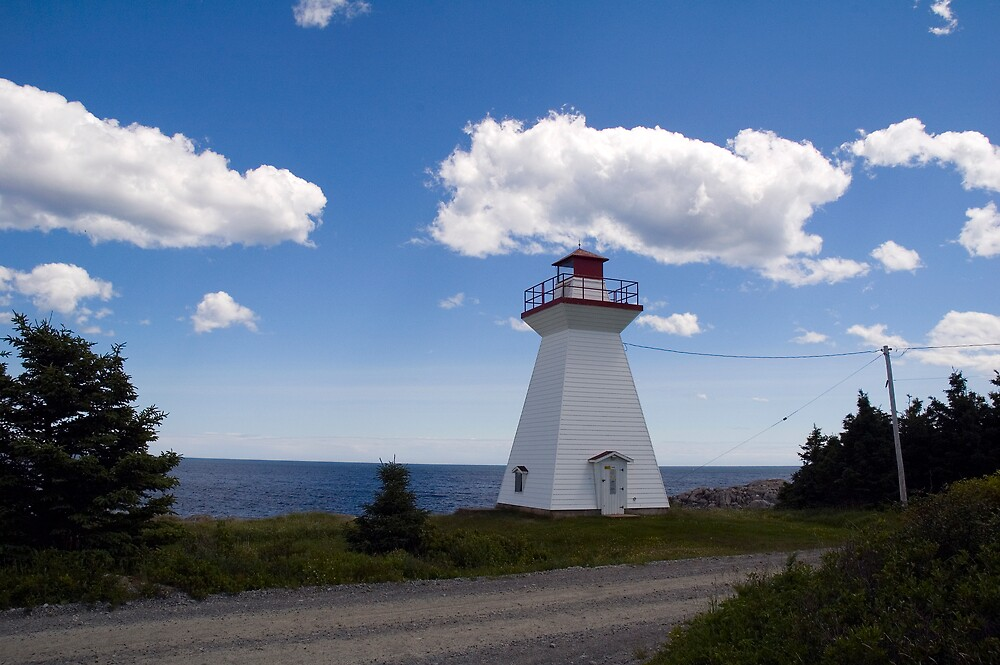 Lighthouse by the sea by Roxane Bay