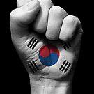 Flagge von Südkorea auf einer angehobenen geballten Faust von jeff bartels
