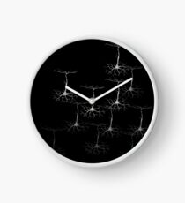 Pyramidal cells on black Clock