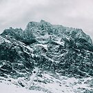 Closeup of Dramatic Snow-Covered Mountain Peak in Norway by visualspectrum