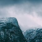 Closeup of Norwegian Mountains on Moody Winter Day by visualspectrum