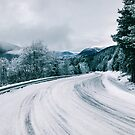 Norway in Wintertime - Valley and Snow-Covered Mountain Road by visualspectrum