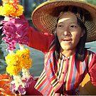 Girl flower trader on Klongs of Bangkok by Bev Pascoe