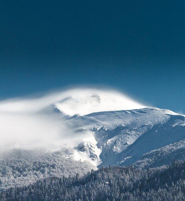 Misty clouds over snowy mountain Snežnik, Slovenia by Patrik Lovrin
