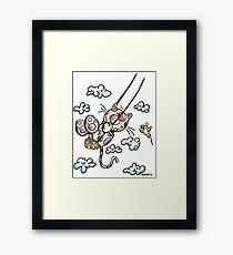 Swinging Cat Framed Print