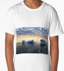 Ice in sea water against the sunset sky Long T-Shirt