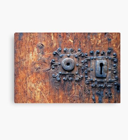 Old door with 3 keyholes Canvas Print