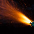 Burning fuse with sparks on black background by Lukasz Szczepanski