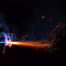 Burning fuse with sparks and blue smoke isolated on black background by Lukasz Szczepanski