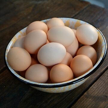 Fresh eggs on an old farm table by Hickoryhill