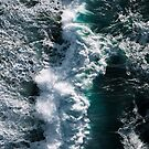 Aerial of Powerful Ocean Waves during sunset by Michael Schauer