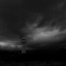Lighthouse in the storm by Marion Ardana