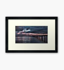 Dramatic Pier Clouds Framed Print