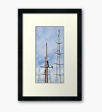 Man between masts. Framed Print