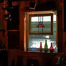 Bottles in a Window by Wayne King