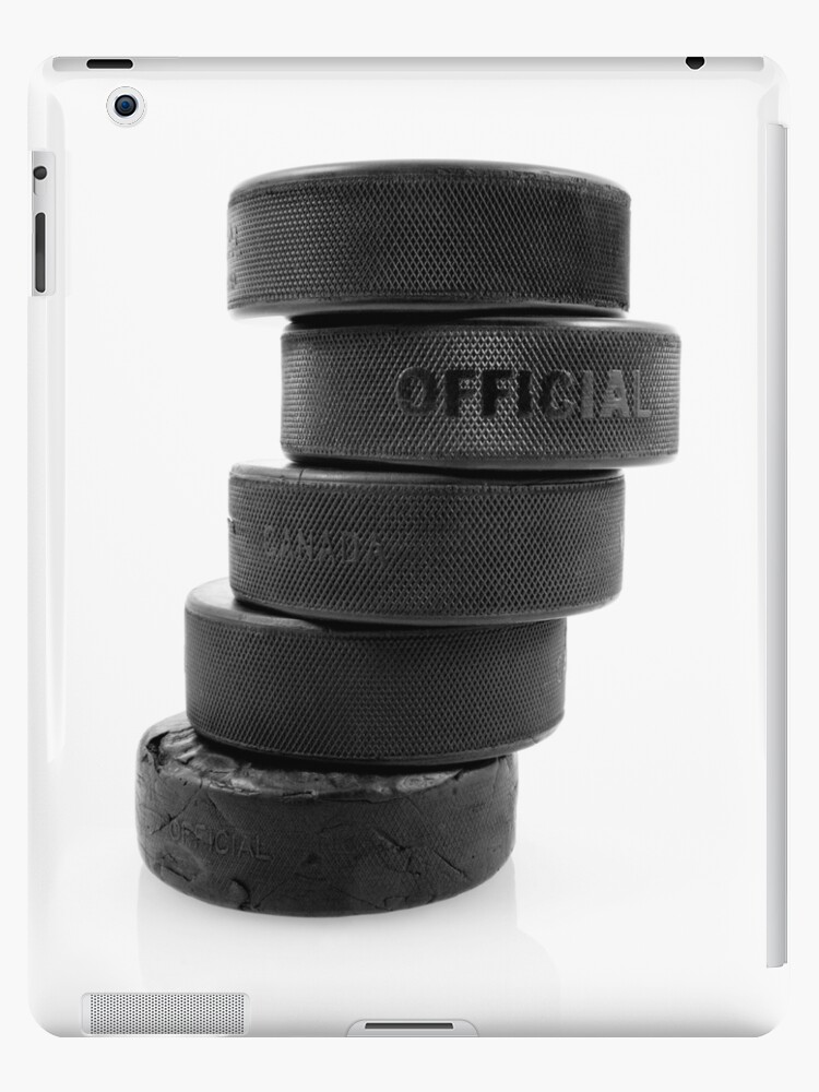 Official ice hockey pucks by Sandra O'Connor