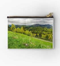 grassy fields on forested hills Studio Pouch