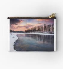 beautiful sunset on the frozen river Studio Pouch