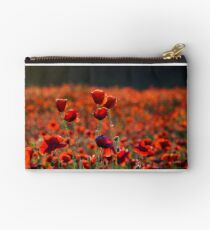 vivid red poppy field at sunset Studio Pouch