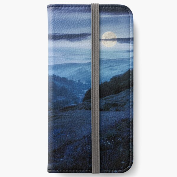 rural valley with forested hills at night iPhone Wallet
