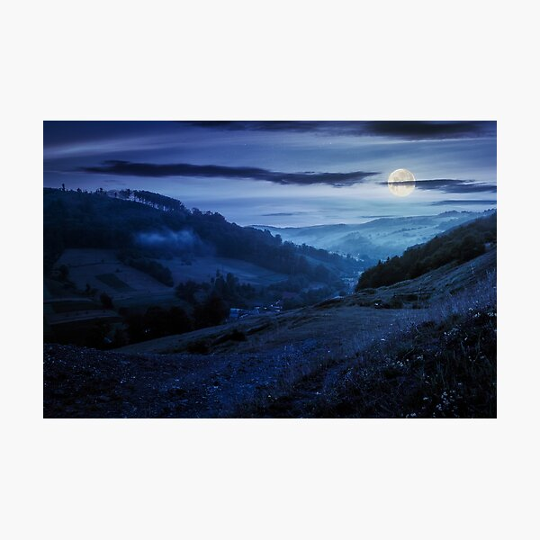 rural valley with forested hills at night Photographic Print