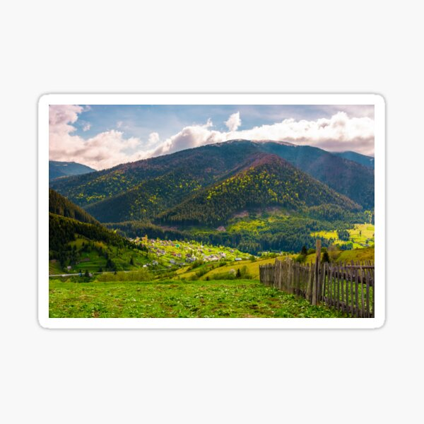 village in valley on a cloudy springtime day Sticker
