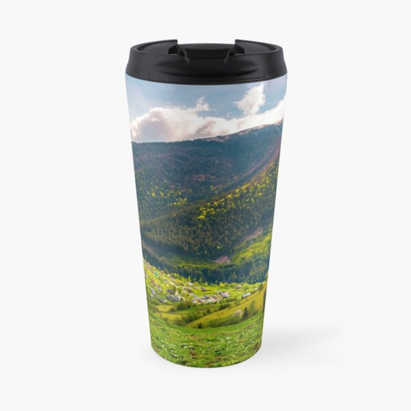 village in valley on a cloudy springtime day Travel Mug