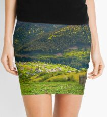 village in valley on a cloudy springtime day Mini Skirt
