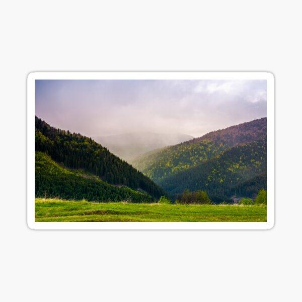 mountains on a cloudy springtime day Sticker