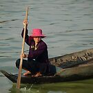 Resident of the floating village, Lake Tonlie Sap, Cambodia by Bev Pascoe