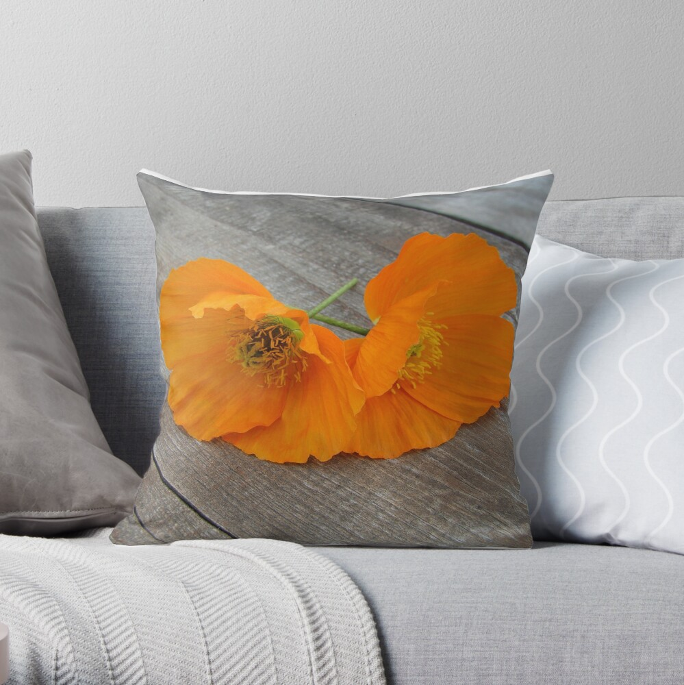 Orange flowers on a wooden table Throw Pillow