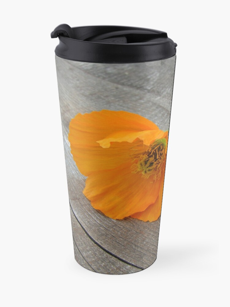 Alternate view of Orange flowers on a wooden table Travel Mug