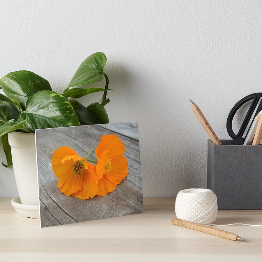 Orange flowers on a wooden table Art Board Print