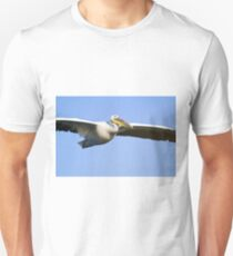 White Pelican, Pelecanus onocrotalus in flight with a blue sky background. Unisex T-Shirt
