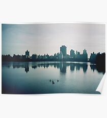 Film photo of Central Park, New York City, with its lake and surrounded buildings Poster