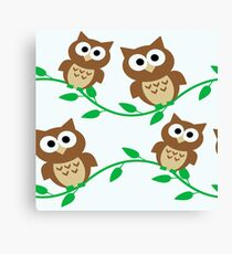 Cartoon Owls sitting on a branch Canvas Print