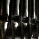 Pipes in the shadows by Richard Shepherd