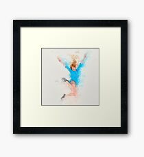 Digitally enhanced image of a smiling young woman jumping with joy Framed Print