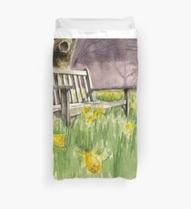 Bench in daffodils  Duvet Cover