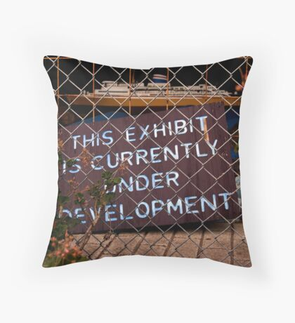 under development Throw Pillow