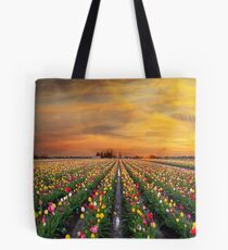 Sunset over colorful Tulip flower fields in full bloom during spring season tulip festival in Woodburn Oregon Tote Bag